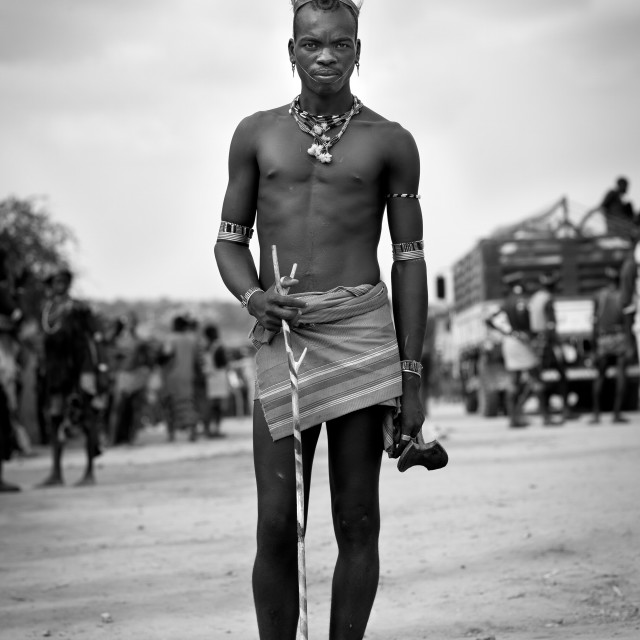 """Portrait Of Bare Chest And Feather Headgear Banna Whipper Man Omo Valley..."" stock image"