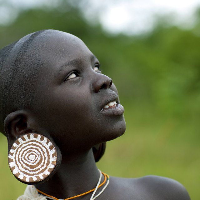 """""""Surma Girl Watching A Donga Session, Omo Valley, Ethiopia"""" stock image"""