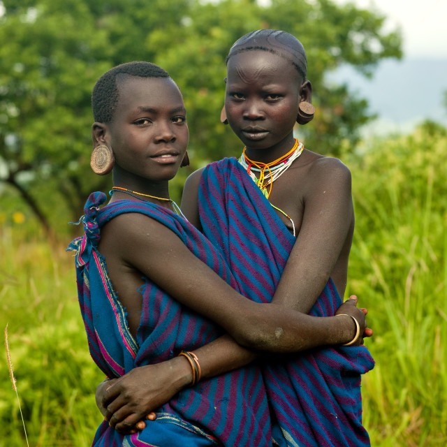 """Couple Of Surma Teenagers,turgit Village, Omo Valley, Ethiopia"" stock image"