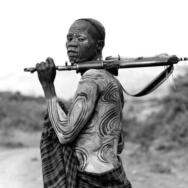 """Suri Man With Body Decoration And A Kalashnikov, Turgit Village, Omo Valley,..."" stock image"