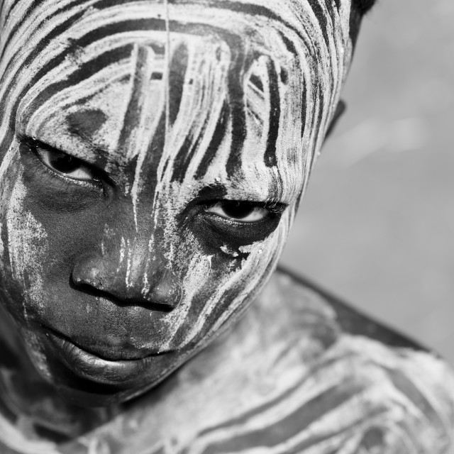 """""""Portrait Of Young Provocative Look Mursi Boy Ethiopia"""" stock image"""