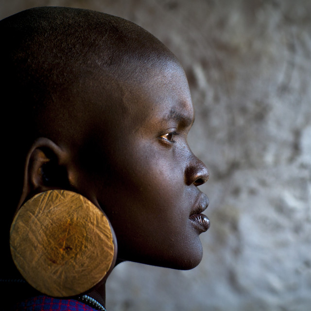 """Portrait Of A Young Mursi Tribe Woman With Enlarged Ear In Mago National..."" stock image"