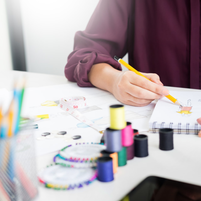 """young women working as fashion designer drawing sketches for clo"" stock image"