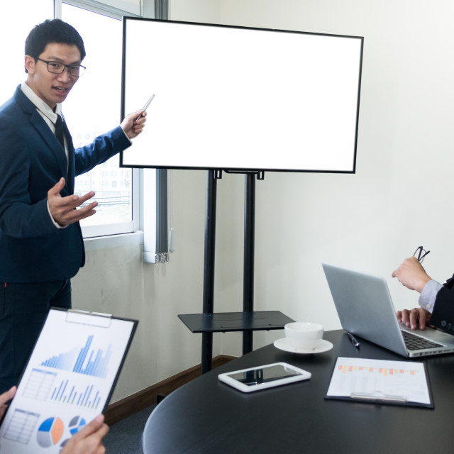 """young business man working presentation using television compute"" stock image"