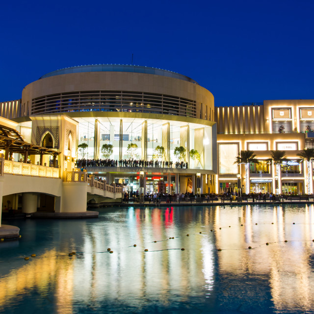 """""""Dubai mall modern architecture reflected in the fountain at blue hour"""" stock image"""
