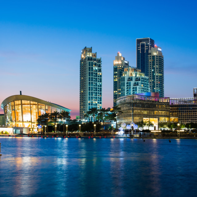 """""""Dubai Opera and modern Dubai downtown skyscrapers reflected in the water at blue hour"""" stock image"""