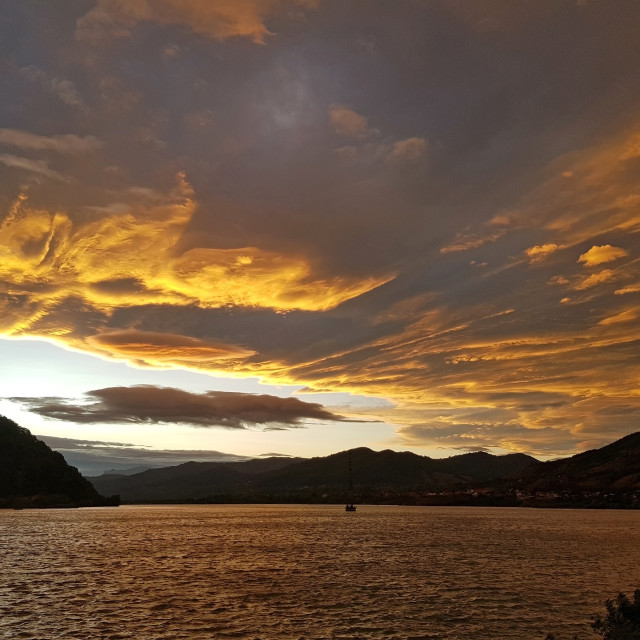 """""""Sunset clouds over the lake"""" stock image"""