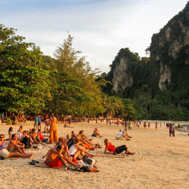 """Travellers getting ready to witness sunset on Railay beach, Krab"" stock image"