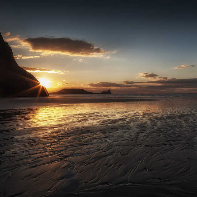"""Sunset and wet sand at Worms Head"" stock image"