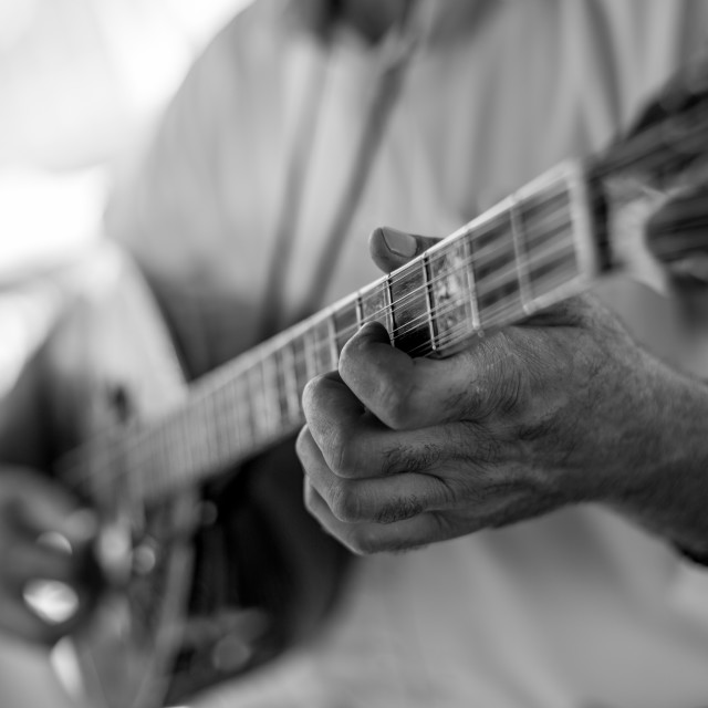 """Close up of man hand playing bouzouki"" stock image"