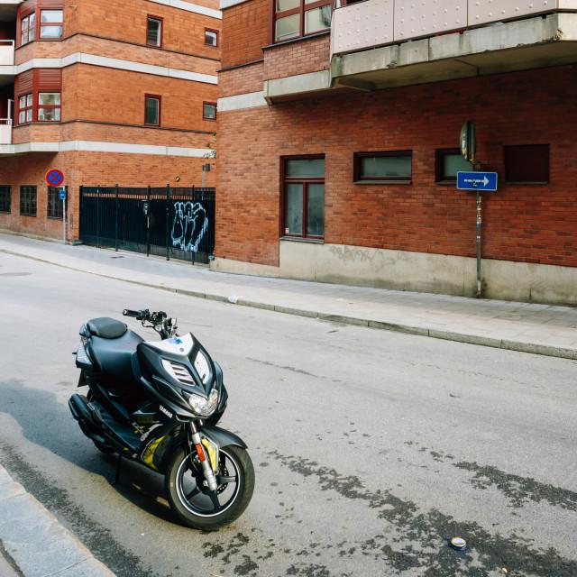 """""""Yamaha scooter parked at sidewalk on the Brunnsgatan street Stockholm, Sweden"""" stock image"""