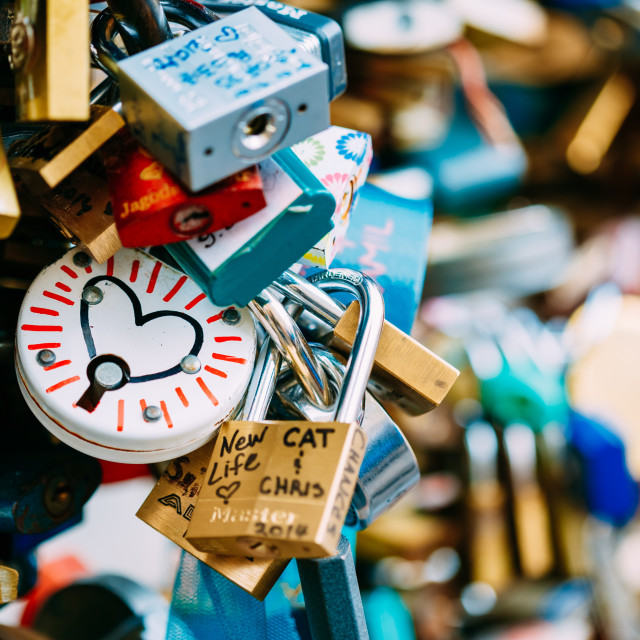 """Love locks on bridge in European town"" stock image"