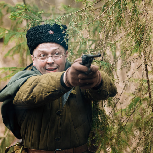 """Unidentified re-enactor dressed as Soviet russian soldier firing a handgun at..."" stock image"