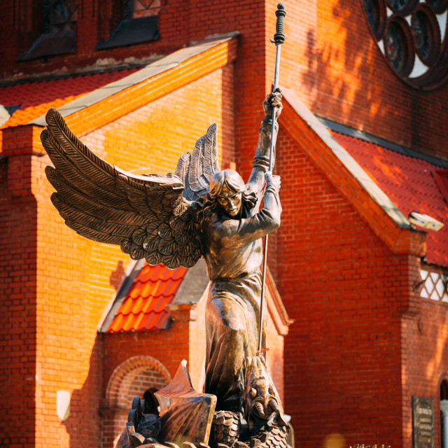"""""""Statue Of Archangel Michael near Red Catholic Church Of St. Simon And St...."""" stock image"""