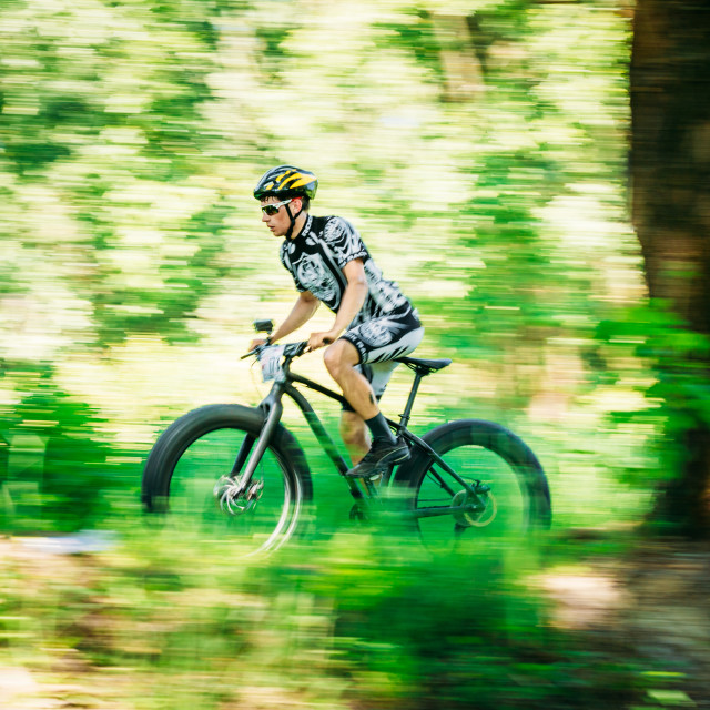 """""""Mountain Bike cyclist riding track on fat tire bike at sunny day."""" stock image"""