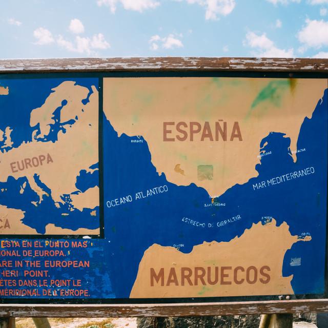 """Old painted Information board on the beach Costa de la Luz in Tarifa, Spain."" stock image"