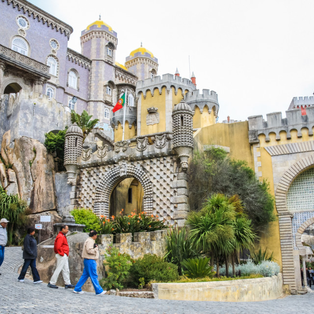 """Visitors outside the entrance gates to the Pena National Palace,"" stock image"