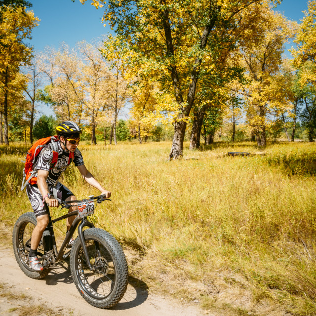 """""""Mountain Bike With Fat Tires Cyclist Riding Track At Sunny Day, Healthy..."""" stock image"""