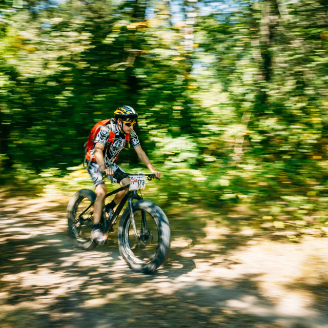 """""""Mountain Bike cyclist riding track at sunny day. Bike with fat tires."""" stock image"""