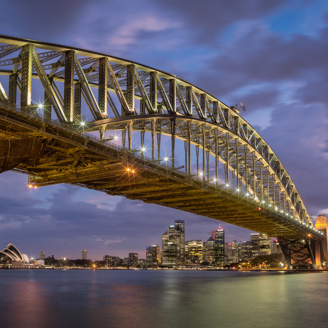 """The Sydney Skyline and Opera House though the gates of the Harbour Bridge"" stock image"
