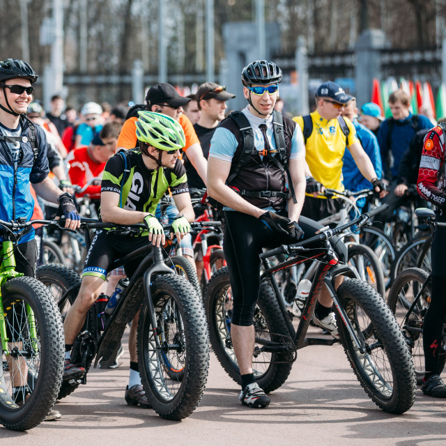 """""""Young men cyclists in sportswear for cycling on fat tires bikes at opening of..."""" stock image"""