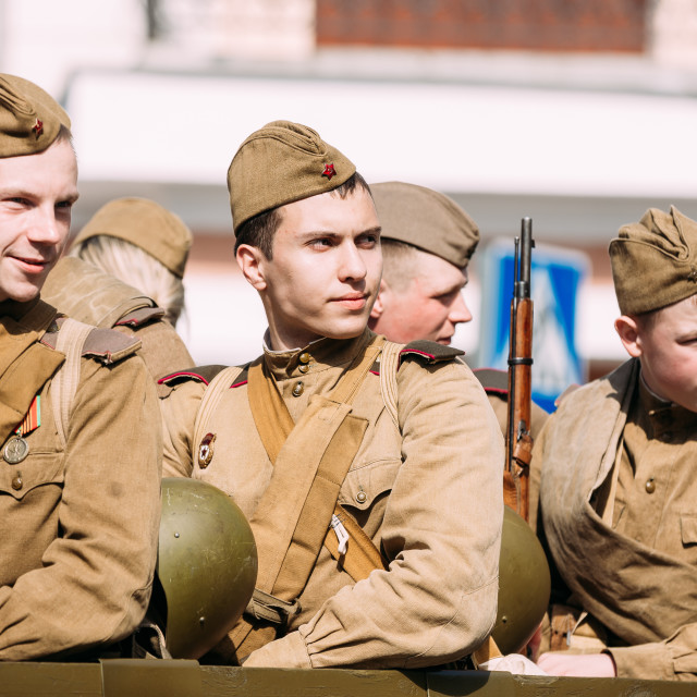 """""""Young Men Soldiers Soviet Uniform With Guns. Participants Of Victory Parade 9..."""" stock image"""