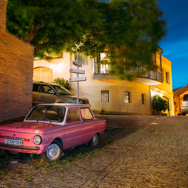 """Parked Rarity Tuning Pink Minicar Zaporozhets On Paved Street In Old District..."" stock image"