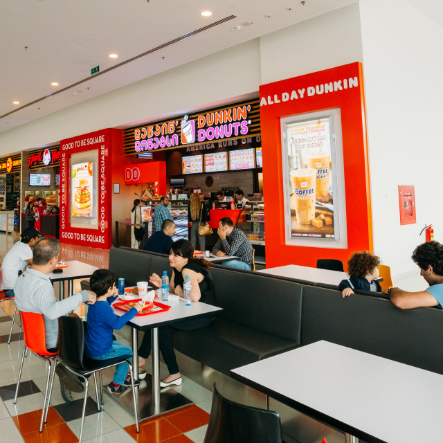 """""""Visitors popular cafe Dunkin Donuts at the modern shopping mall East Point In..."""" stock image"""