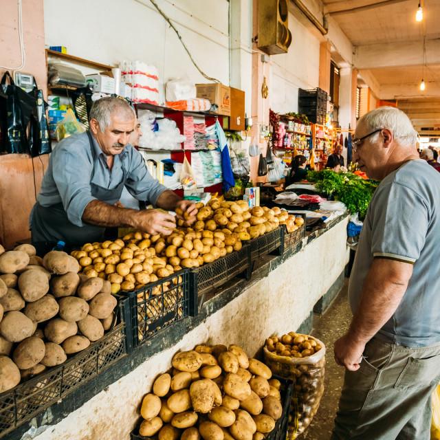 """""""Two Mature Georgian Men, Buyer And Dealer Selling Potato Of New Crop At..."""" stock image"""