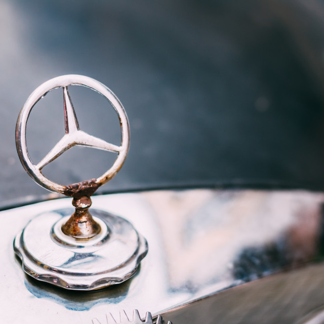 """Close View Of Rusted Welded Metal Logo Of Mercedes Benz At The Hood Of Black..."" stock image"