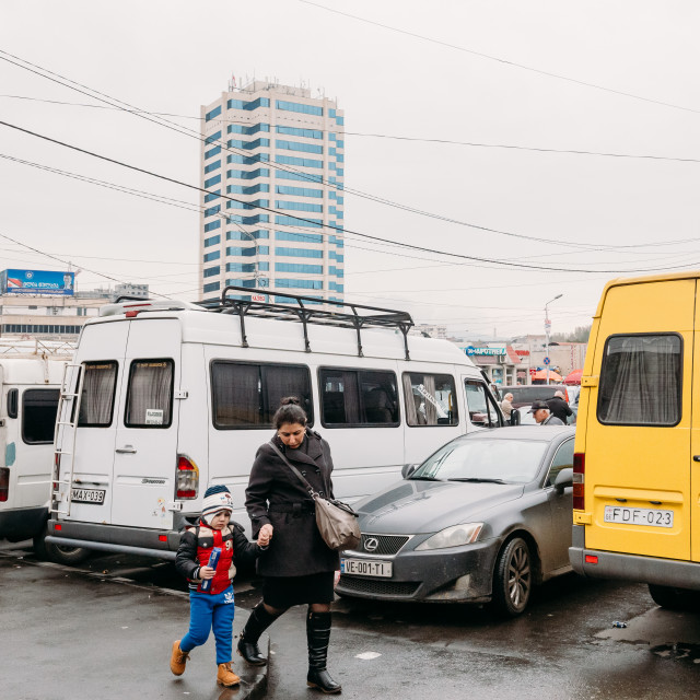 """Tbilisi, Georgia. Woman And Child Walks Near Urban Taxis Minibuses Are On The..."" stock image"