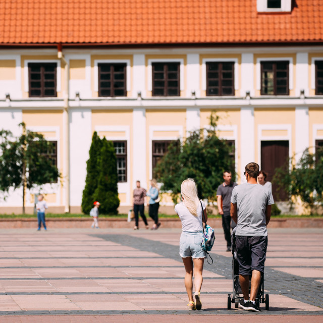 """""""Grodno, Belarus. Young Family Couple With A Stroller Walking Near Old House..."""" stock image"""