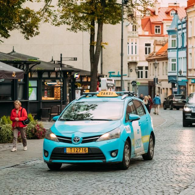 """Vilnius, Lithuania. Toyota Verso Car Smart Taxi Moving On Didzioji Street"" stock image"