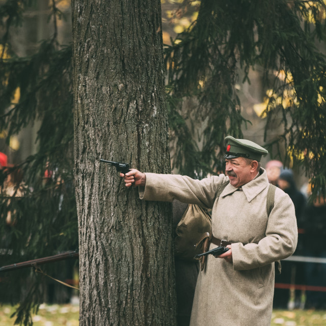 """Gomel, Belarus. Reenactor In Form Of Revolutionary Soldier Shoot Nagant M1895..."" stock image"