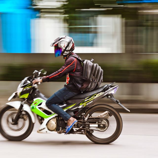 """""""Panning shot of motor riding."""" stock image"""