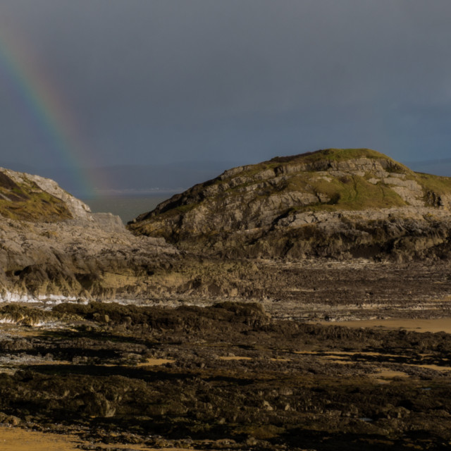 """Rainbow on the shore"" stock image"