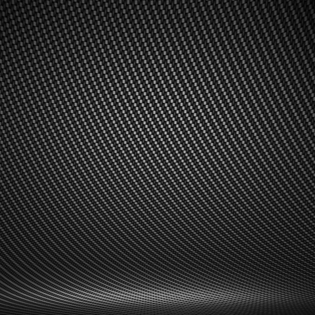 """Black carbon fiber textured interior studio with directional lig"" stock image"
