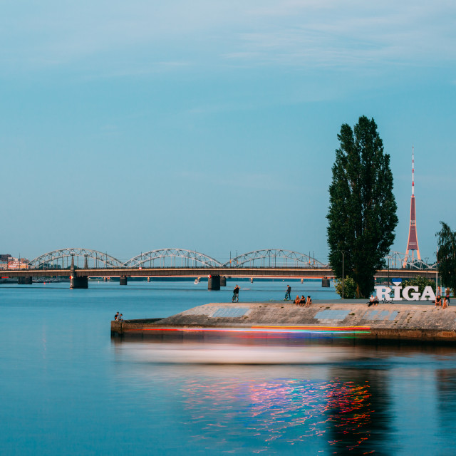 """Riga Latvia. Embankment At Daugava River With City Name Sign, Resting People..."" stock image"