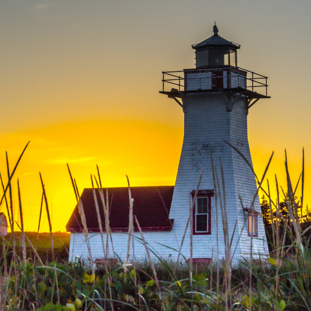 """Backlight small wooden lighthouse at sunset"" stock image"