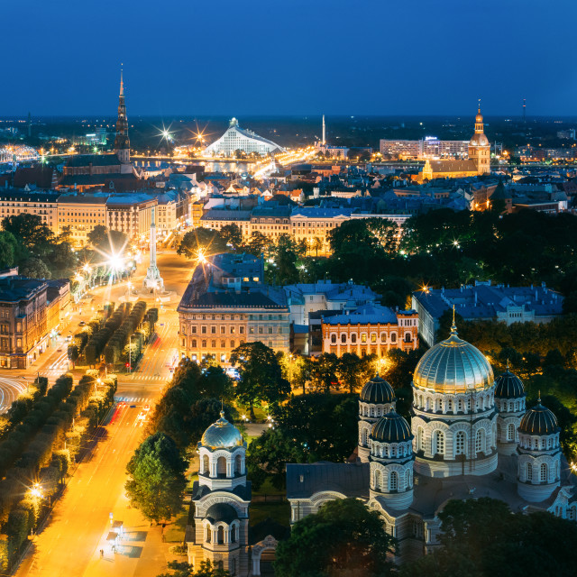 """Riga, Latvia. Cityscape In Evening Night Illumination. St. Peter's Church,..."" stock image"