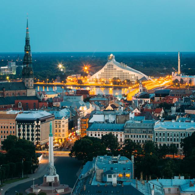 """Riga, Latvia. Aerial View Of Cityscape In Evening Night Lights Illumination...."" stock image"