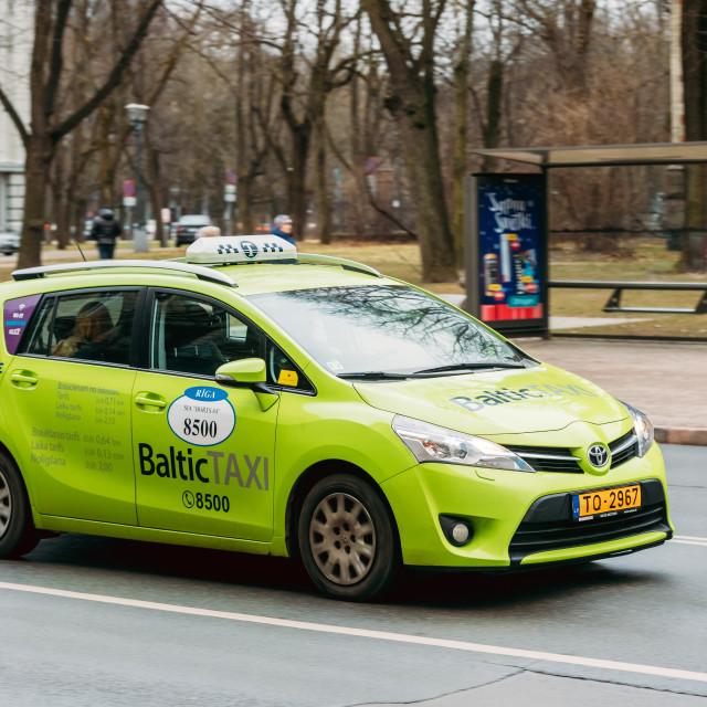 """Riga, Latvia. Toyota Verso Car From Baltic Taxi Moving On Kalpaka Boulevard..."" stock image"