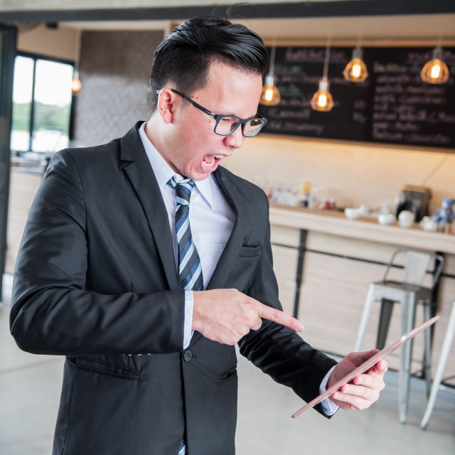 """""""Asian Businessman are pressured to work and unsuccessful"""" stock image"""