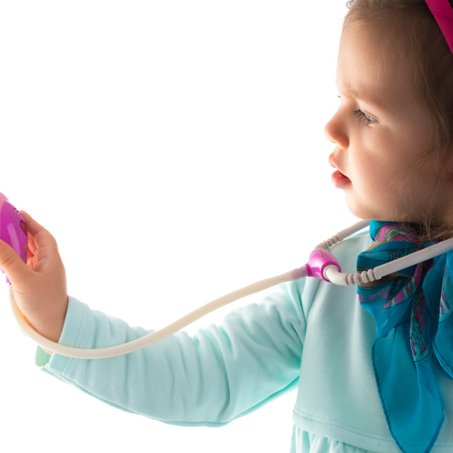"""Young girl with a phonendoscope"" stock image"