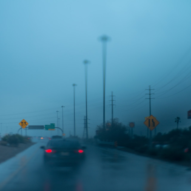 """""""Blurry picture of traffic in rain"""" stock image"""
