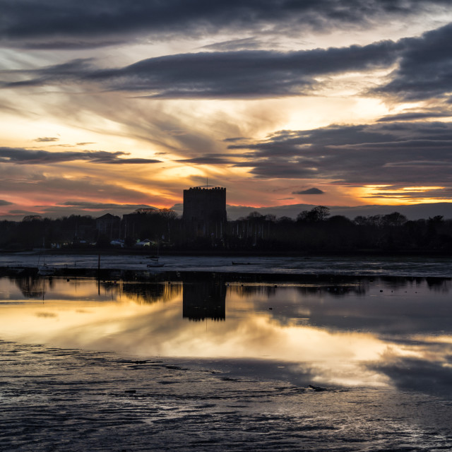 """sillouette of Portchester castle at dusk with sunset, low tide."" stock image"