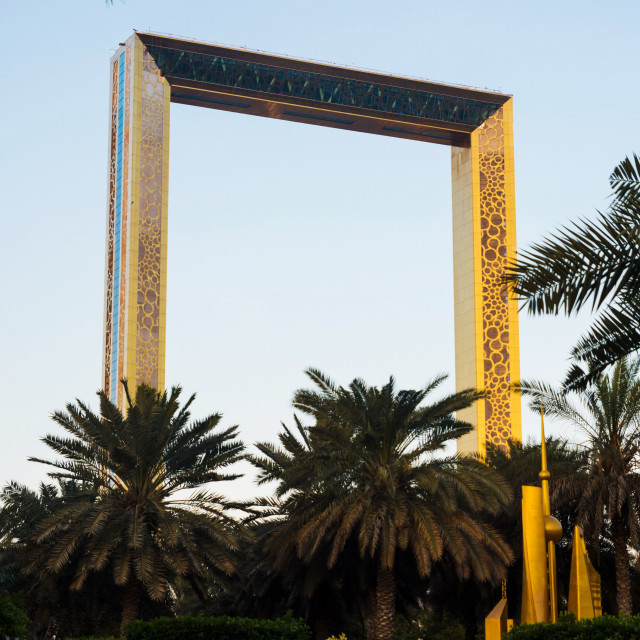"""""""Dubai Frame building with palm trees at dusk"""" stock image"""