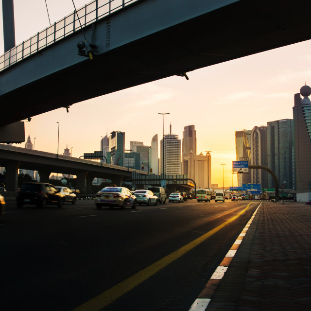 """""""Dubai street scene with constantly alive traffic with new city view at sunset"""" stock image"""