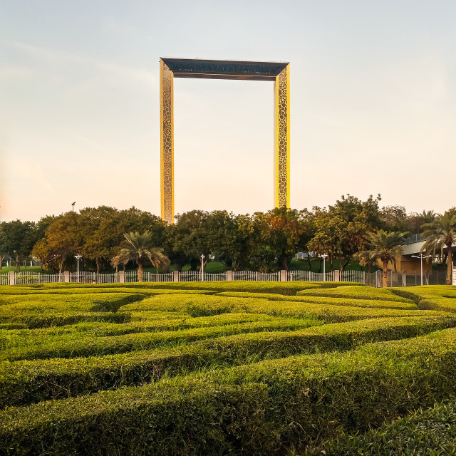 """""""Dubai Frame building with palm trees at sunset."""" stock image"""