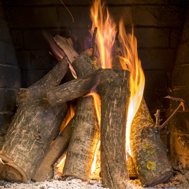 """""""Burning and glowing pieces of wood in Fireplace"""" stock image"""